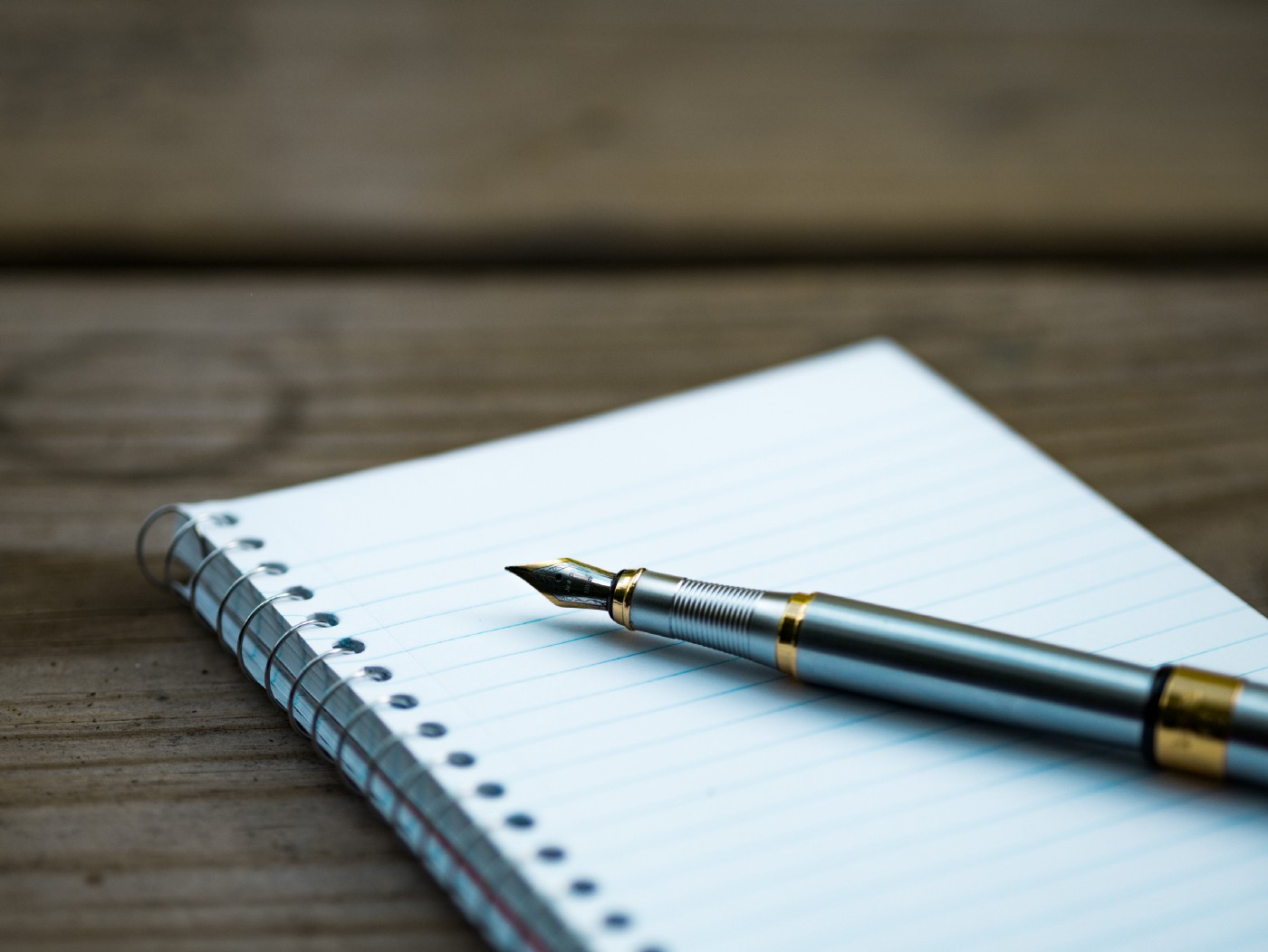 A pen on a writing pad.