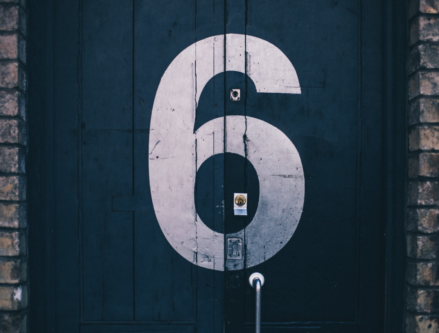 A door with the number six painted on it