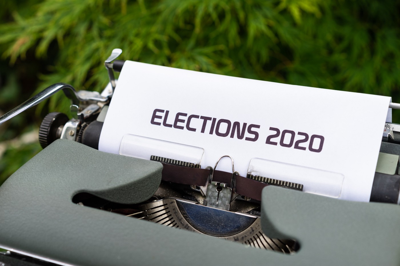 """typewriter with the words """"ELECTIONS 2020"""" typed in block letters on a piece of paper"""