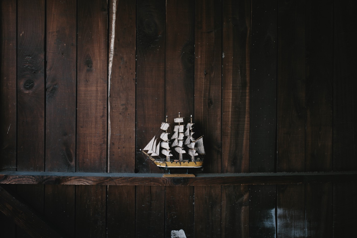 Toy sailboat on a wooden shelf