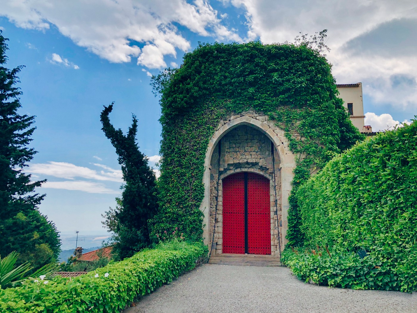 Mansion entrance with a red door