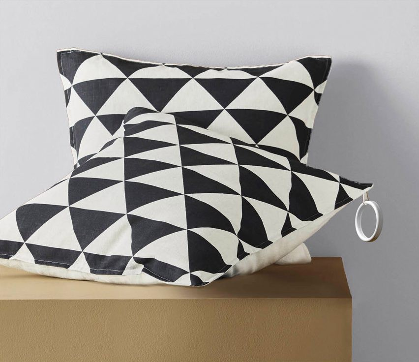 A cushion cover with a large ring attached to the zipper to make it easier to grab/find.
