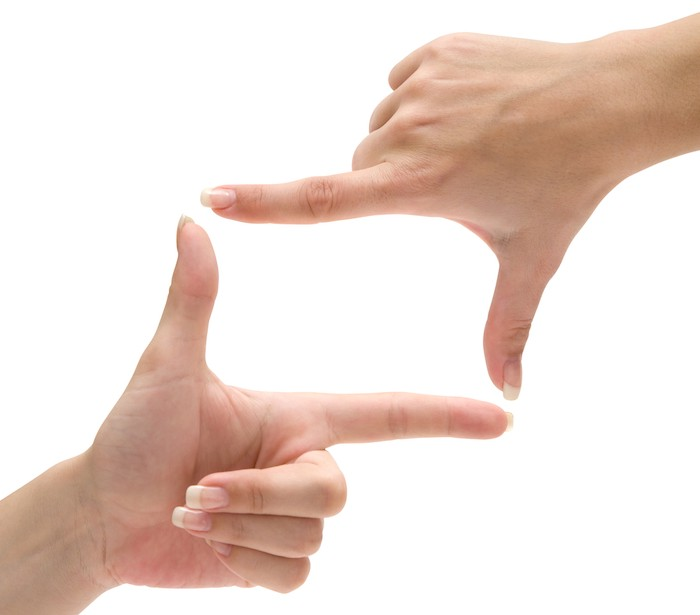 hands making picture frame with fingers