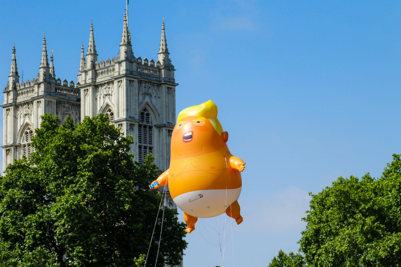 """The infamous """"Baby Trump"""" balloon, looking fat, dumb, and angry"""