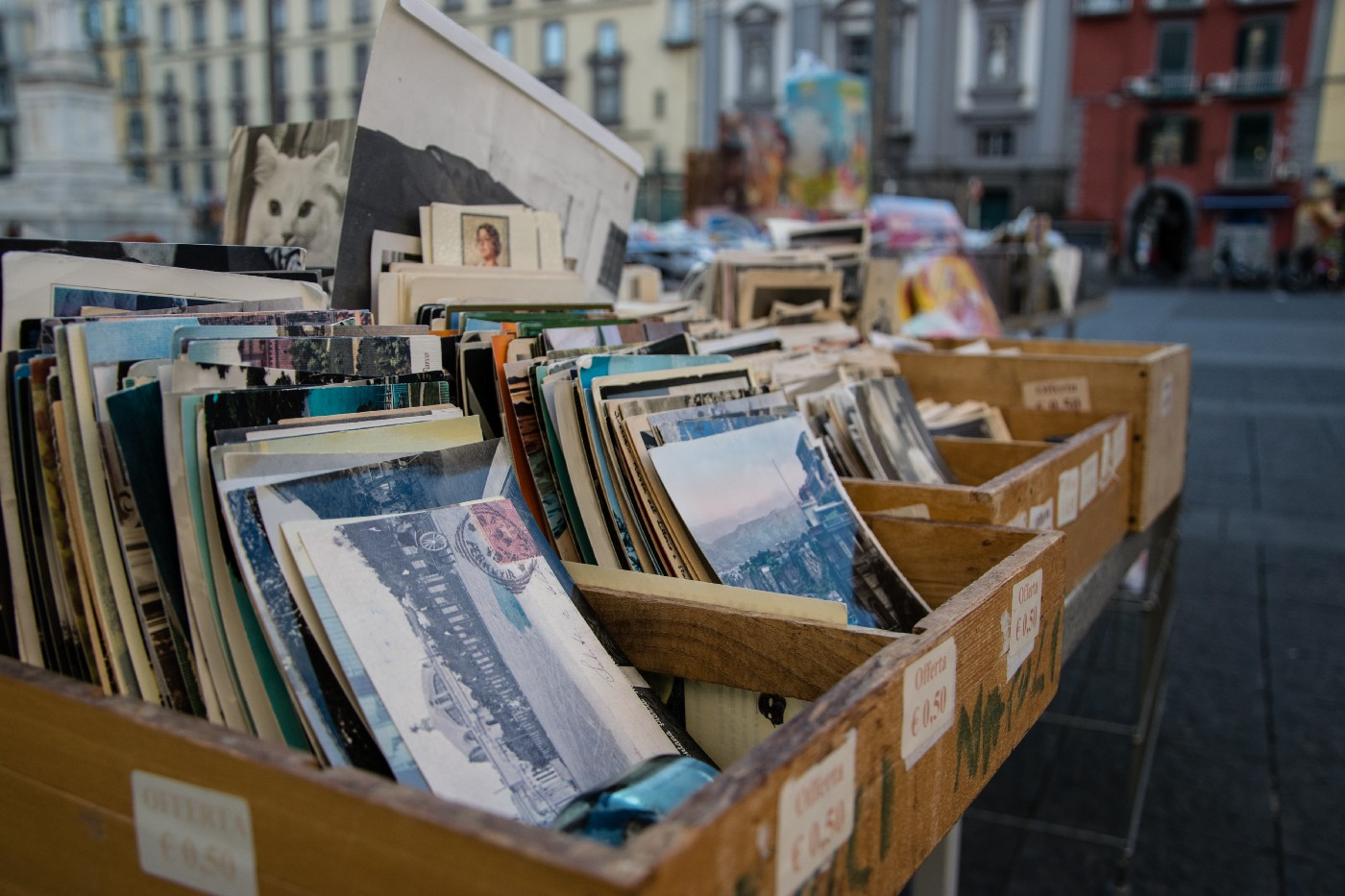 A collection of records in wooden boxes for sale.