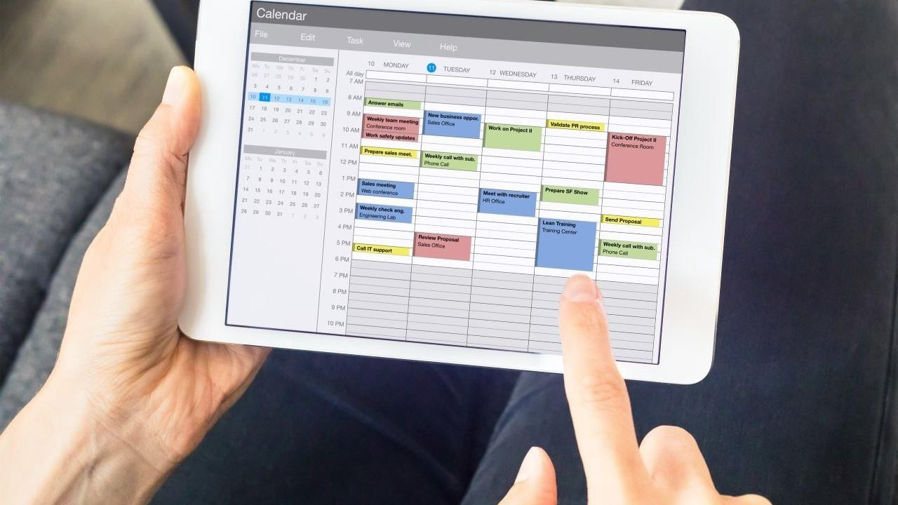 Person looking at calendar on tablet