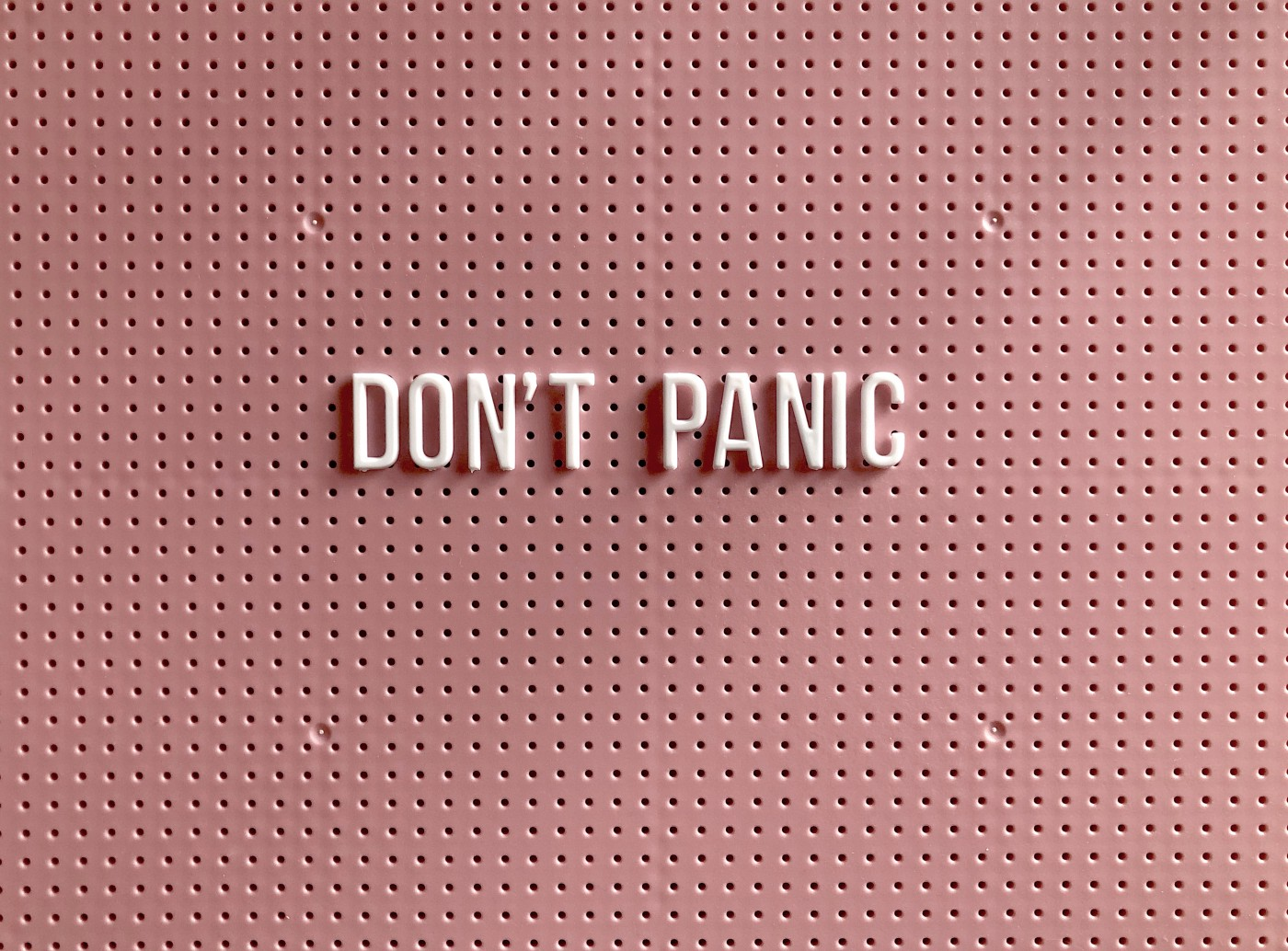 "A sign with the words ""Don't Panic"""