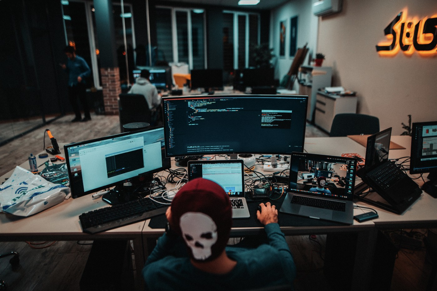 A Programmer coding at his workstation.