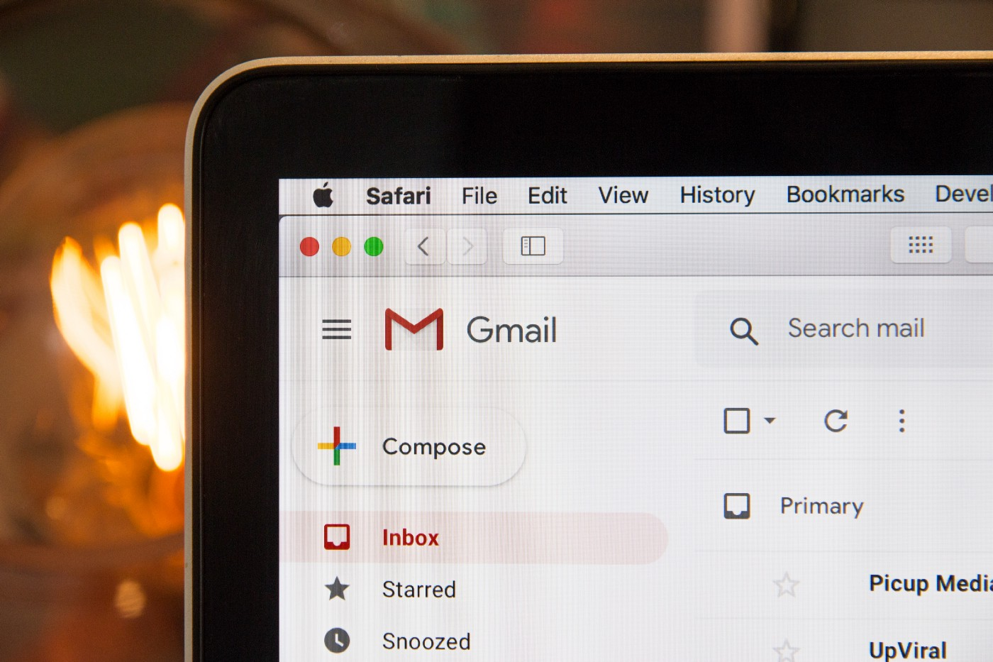 A shot of a laptop showing Gmail on the screen.