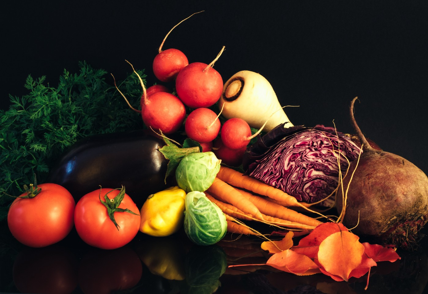A pile of vegetables such as brinjal, tomato, carrots etc.