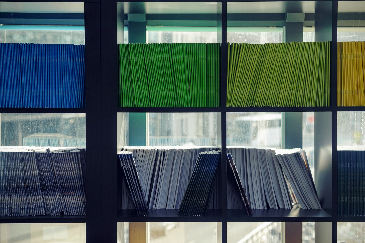 colored file folders organized by color on shelves