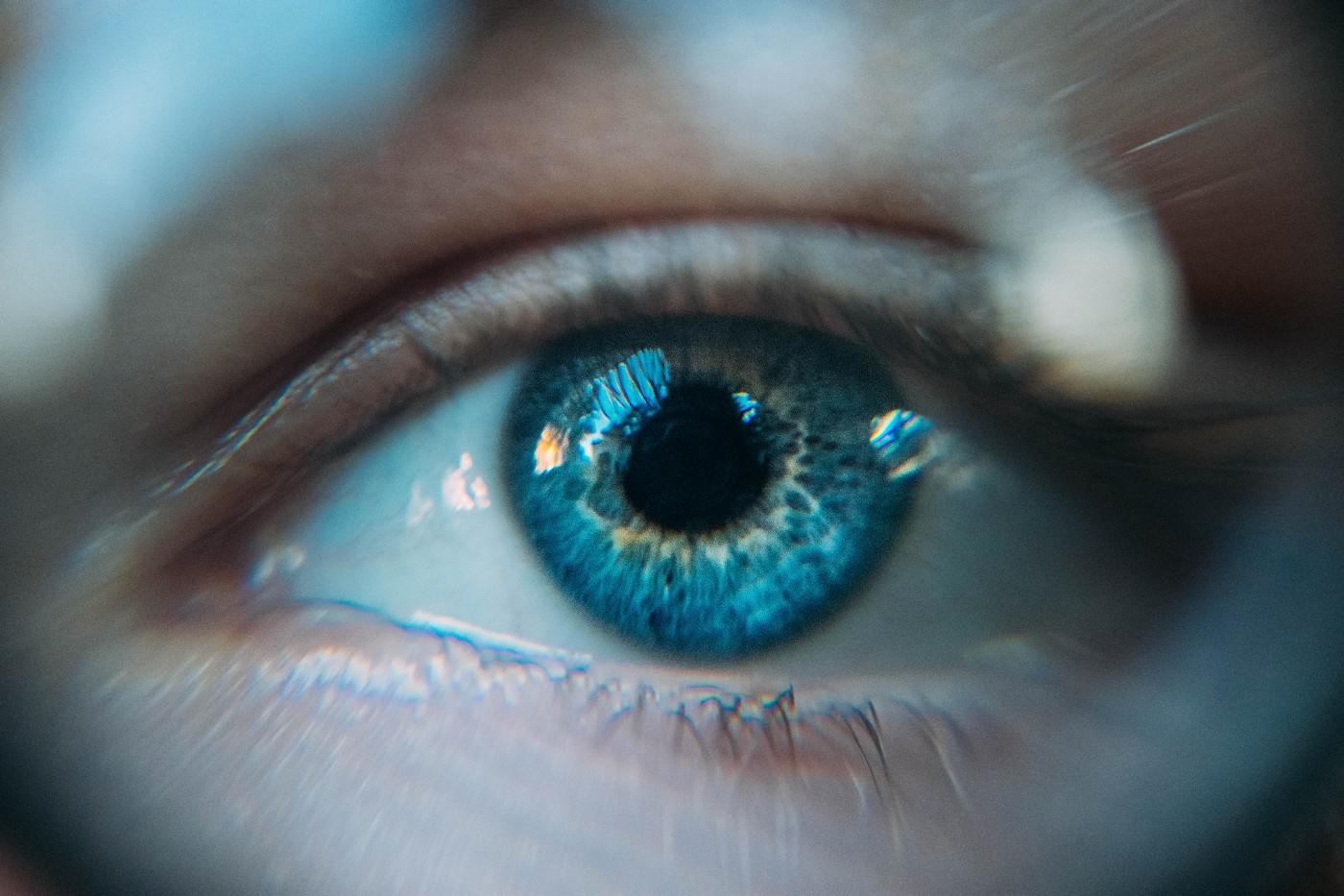 A close-up image of a woman's eye, which is blue.