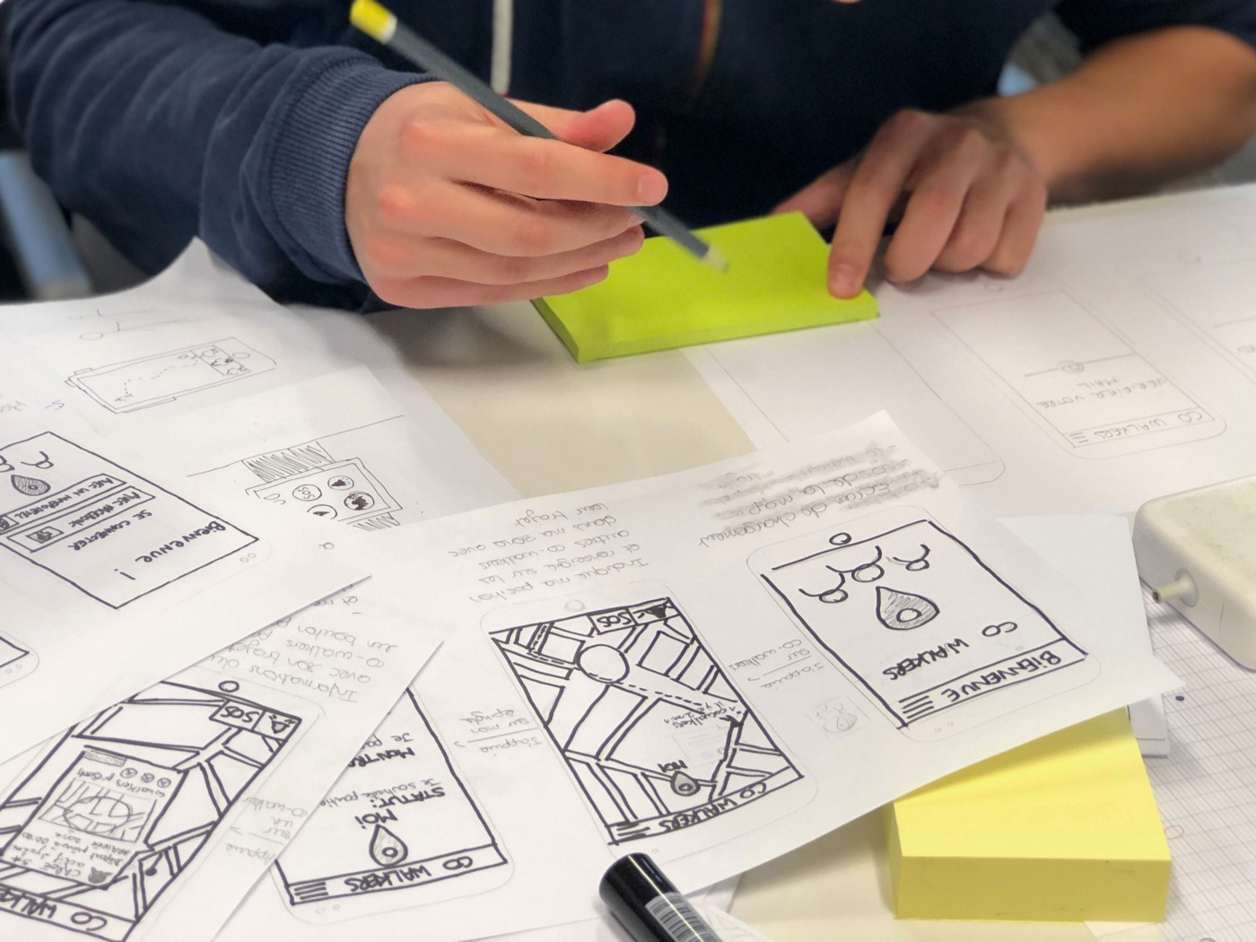 Hand-drawn screens of a prototype for an app