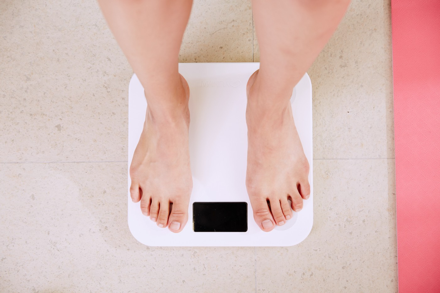 Standing on weighing scale.