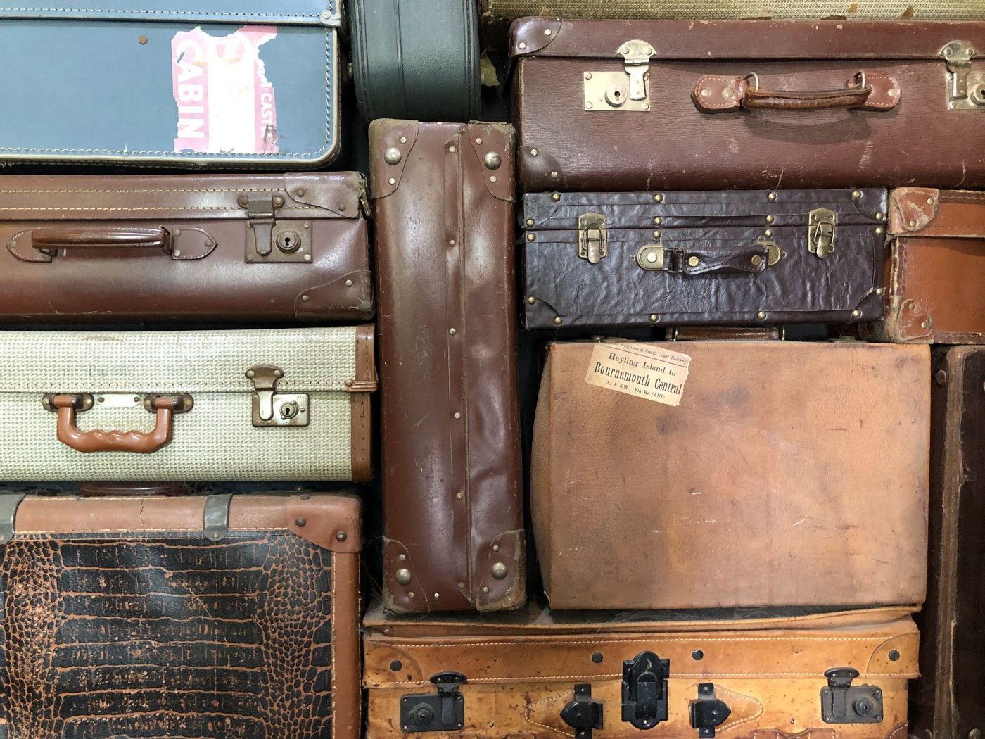Stack of vintage suitcases.