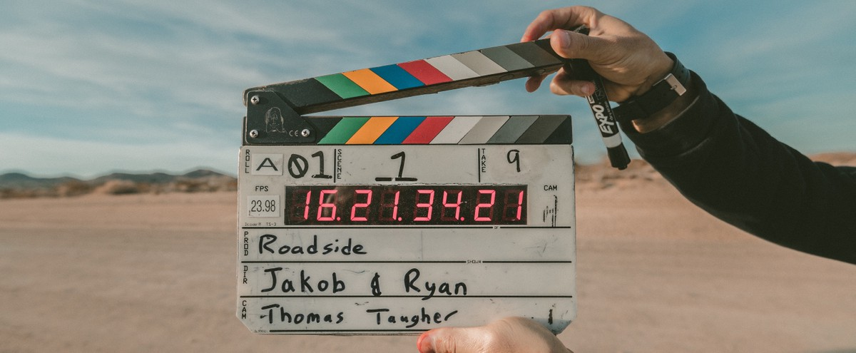 Person holding clapperboard.