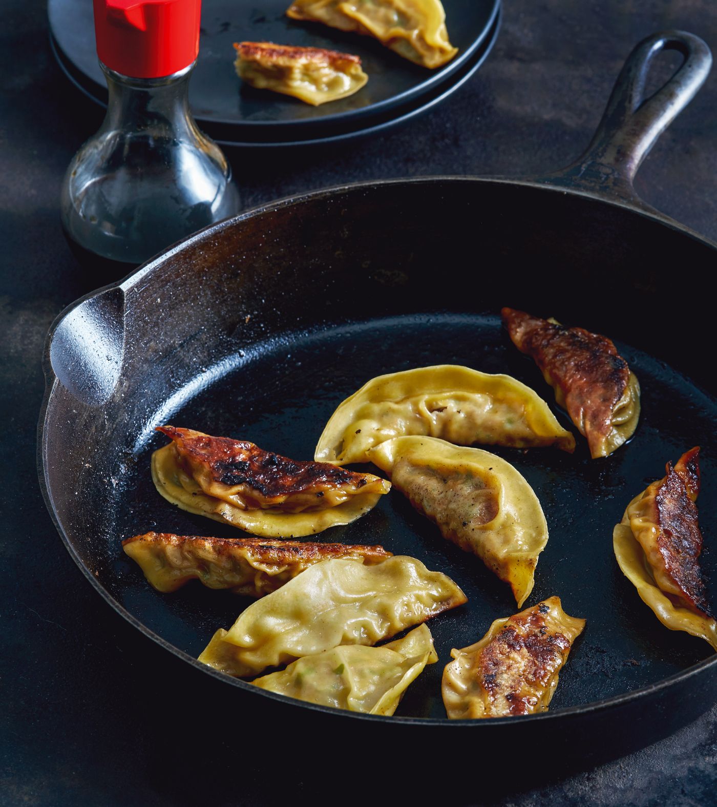 Pot Stickers in a cast-iron pan.