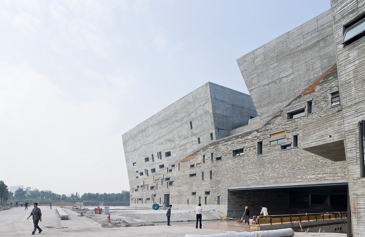 Completed in 2008, Wang Shu's Ningbo History Museum is both an architectural masterpiece and a testament to his approach to localized materials. He used recycled material from traditional Chinese building remains to construct the museum. (Photo: Iwan Baan for Amateur Architecture Studio, Beauty and the East)