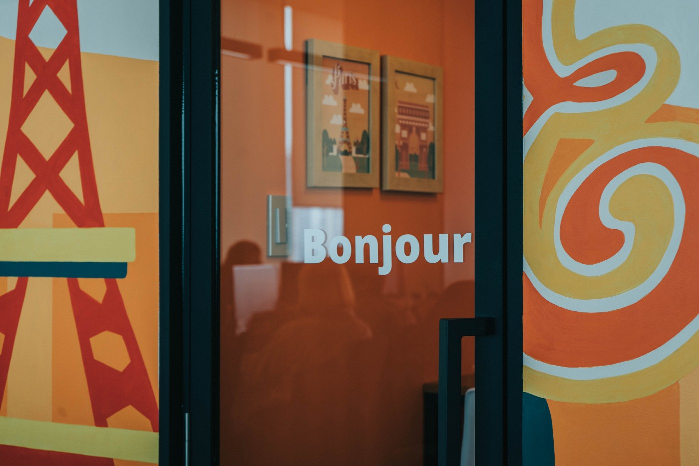 "Storefront that reads ""Bonjour."""
