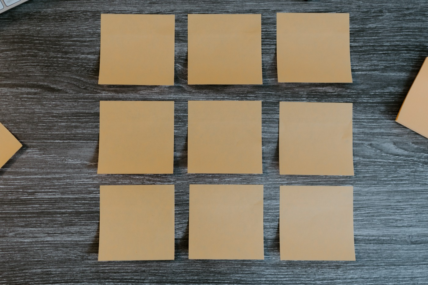 Nine posted notes organized making a big square