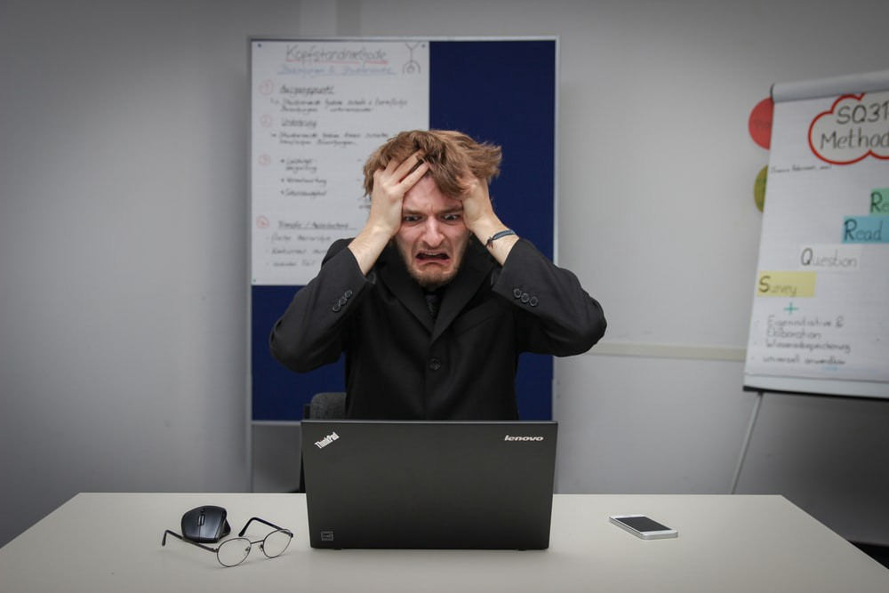 frustrated guy looking at his laptop