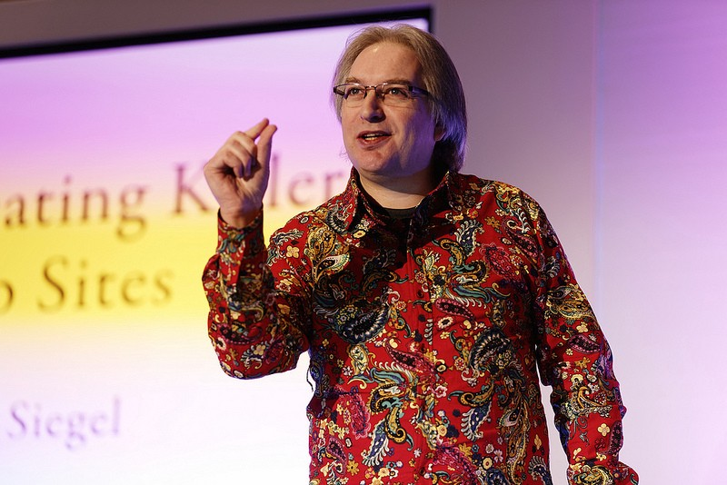 Wearing my eye-watering loud paisley shirt on stage at New Adventures.