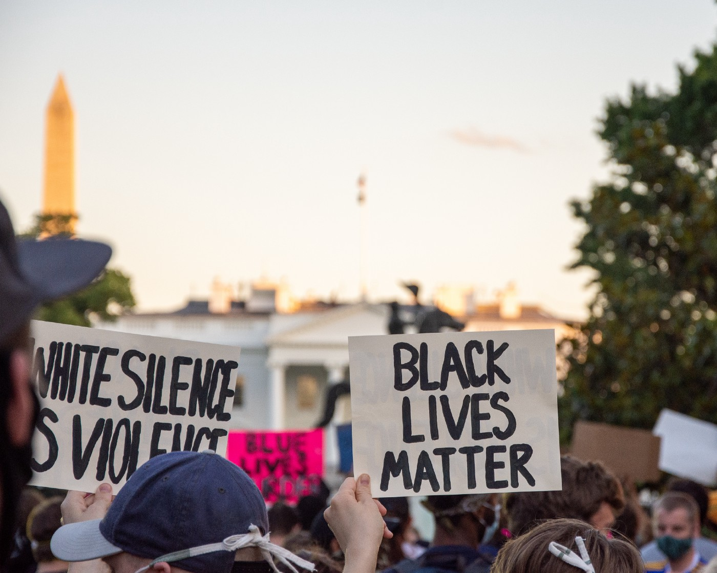 """Photo of Black Lives Matter protesters in Washington, D.C.—2 signs say """"Black Lives Matter"""" and """"White Silence is Violence"""""""