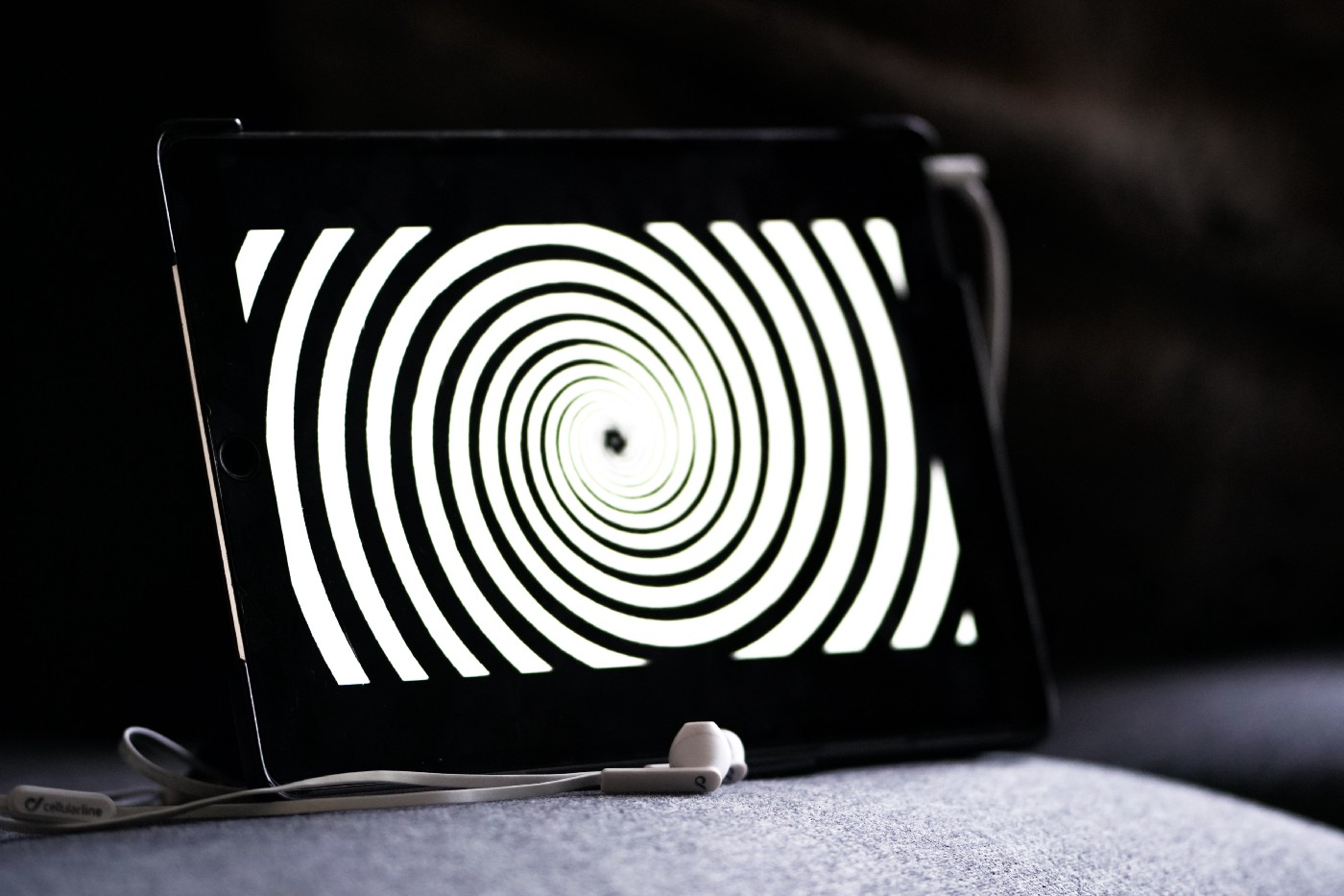iPad displaying a black and white spiral pattern.
