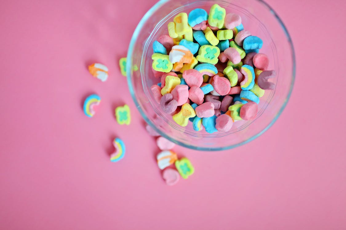 A bowl of Lucky Stars against a pink background