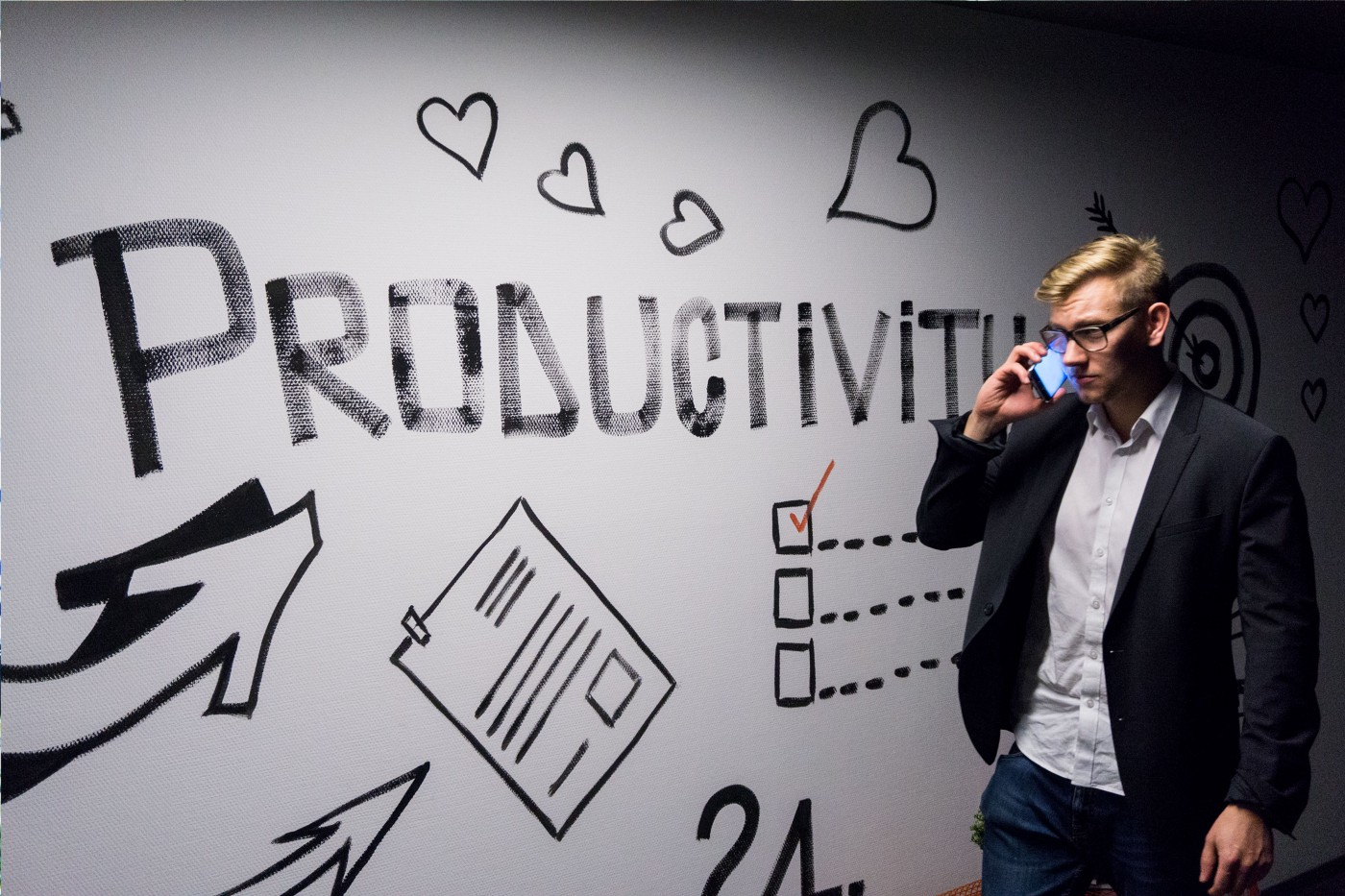 """Leader with a whiteboard behind him on which is written """"productivity."""""""