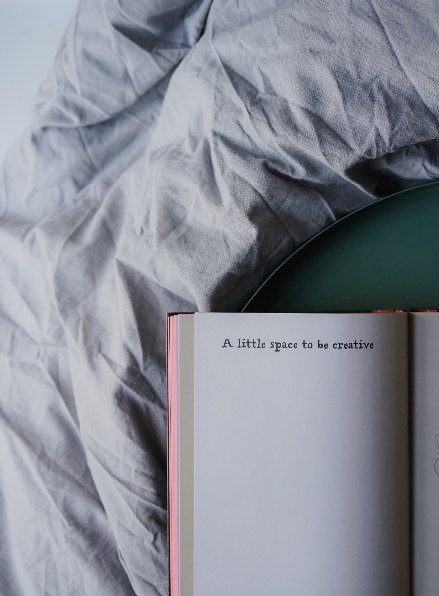 "A book with the words ""a little space to be creative"" written on a page."