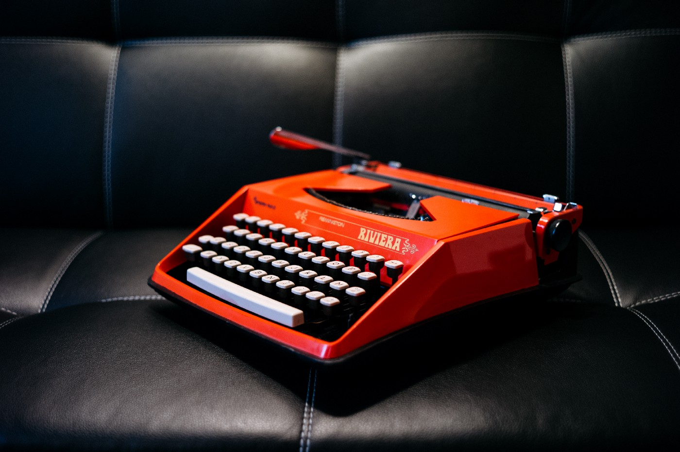 old red typewriter on a couch