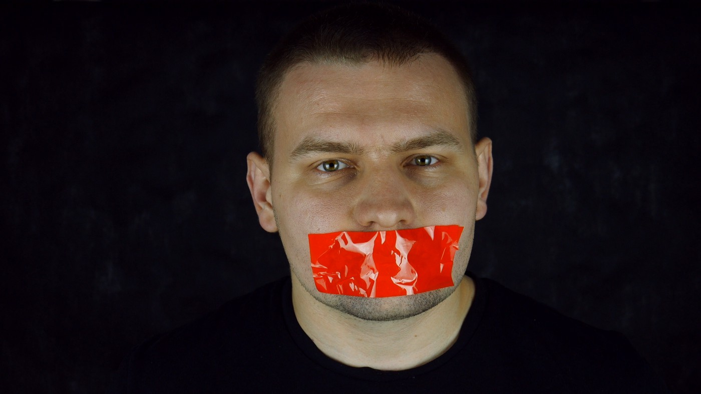 A white guy with red tape on his mouth. Probably something the world could use more of.
