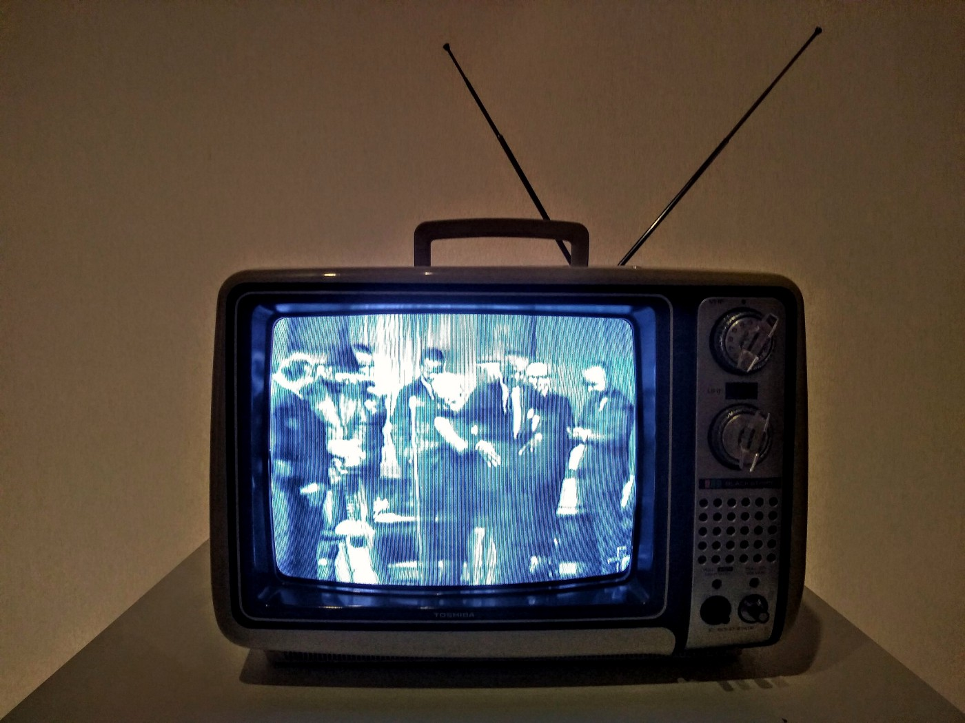 A black and white television with antenna