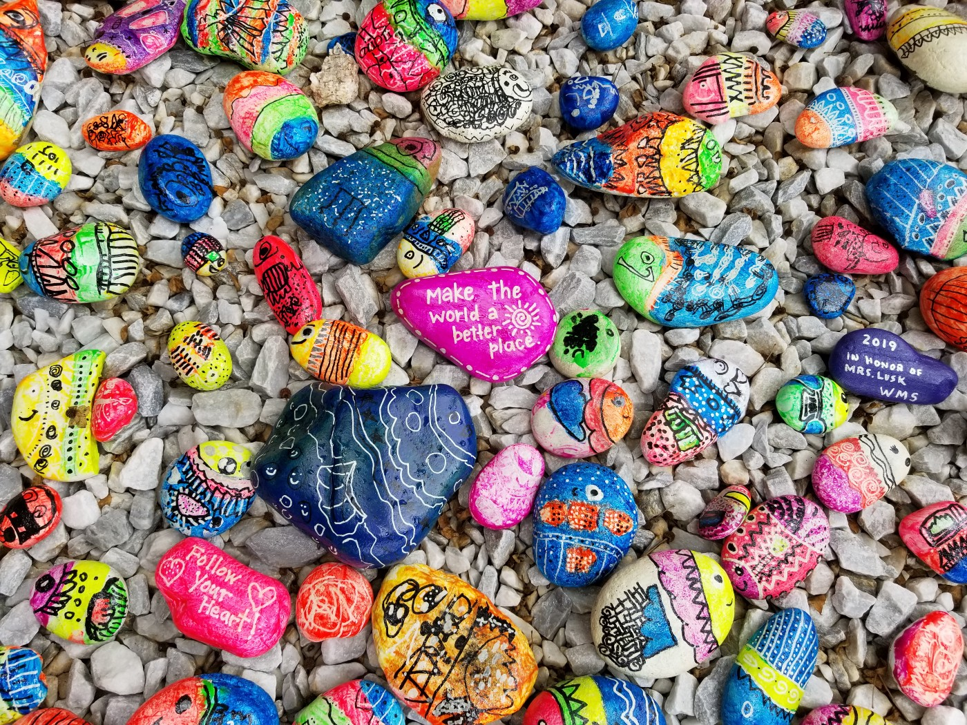 Picture of painted rocks with affirmations painted on them