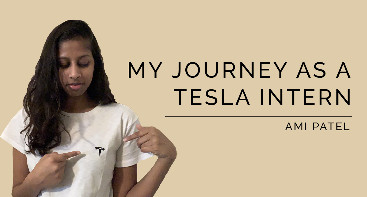 A picture of the author, Ami pointing to the Tesla logo on her shirt.