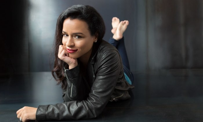 Sarah Cooper poses in a leather jacket