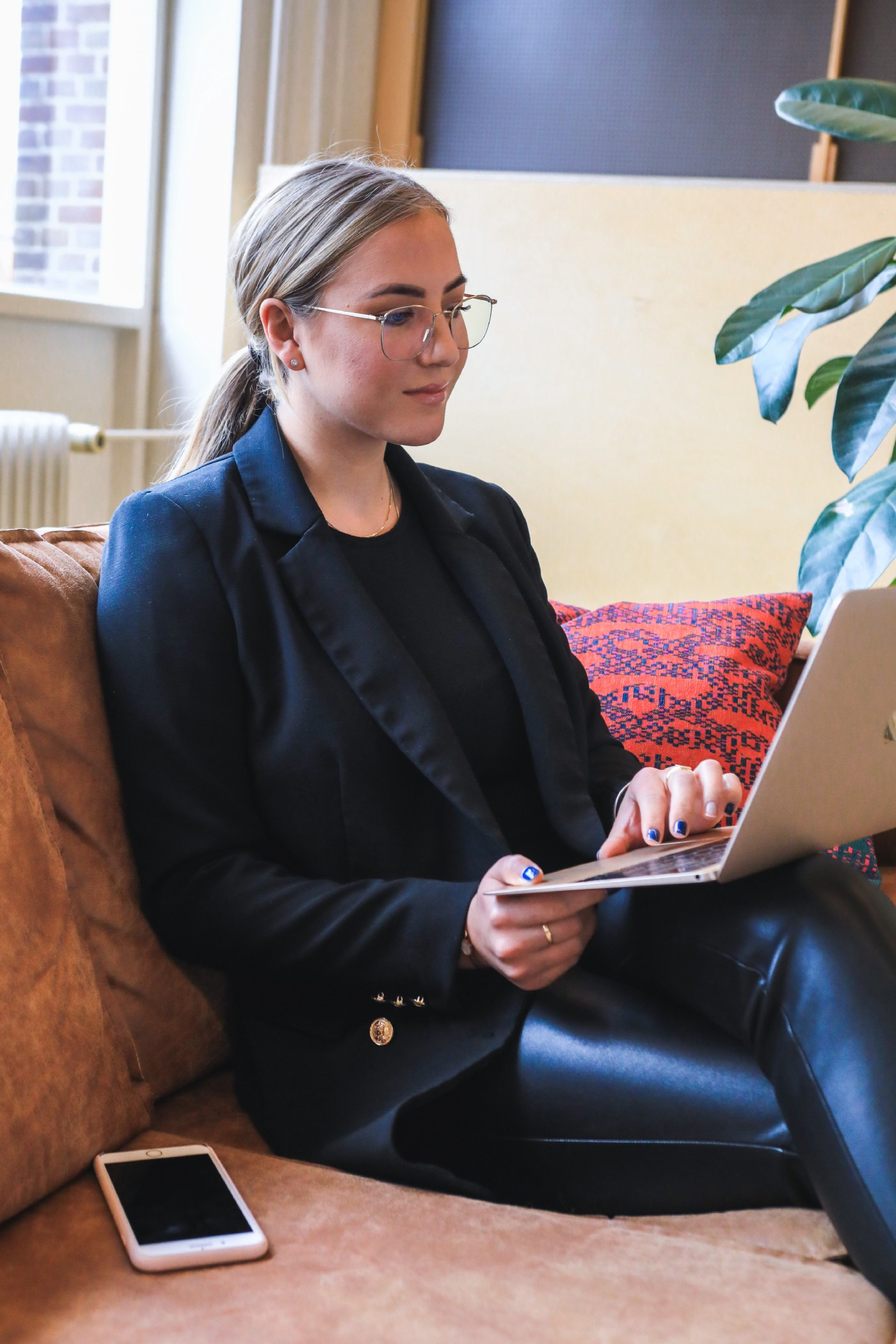Women looking a computer with ad from woman wholesaler trying to sell a house
