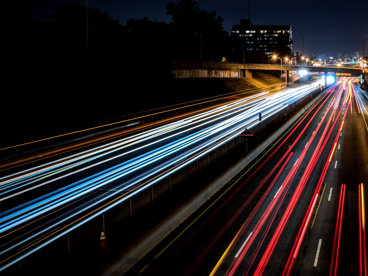 Cars going fast on the highway—blurred lights