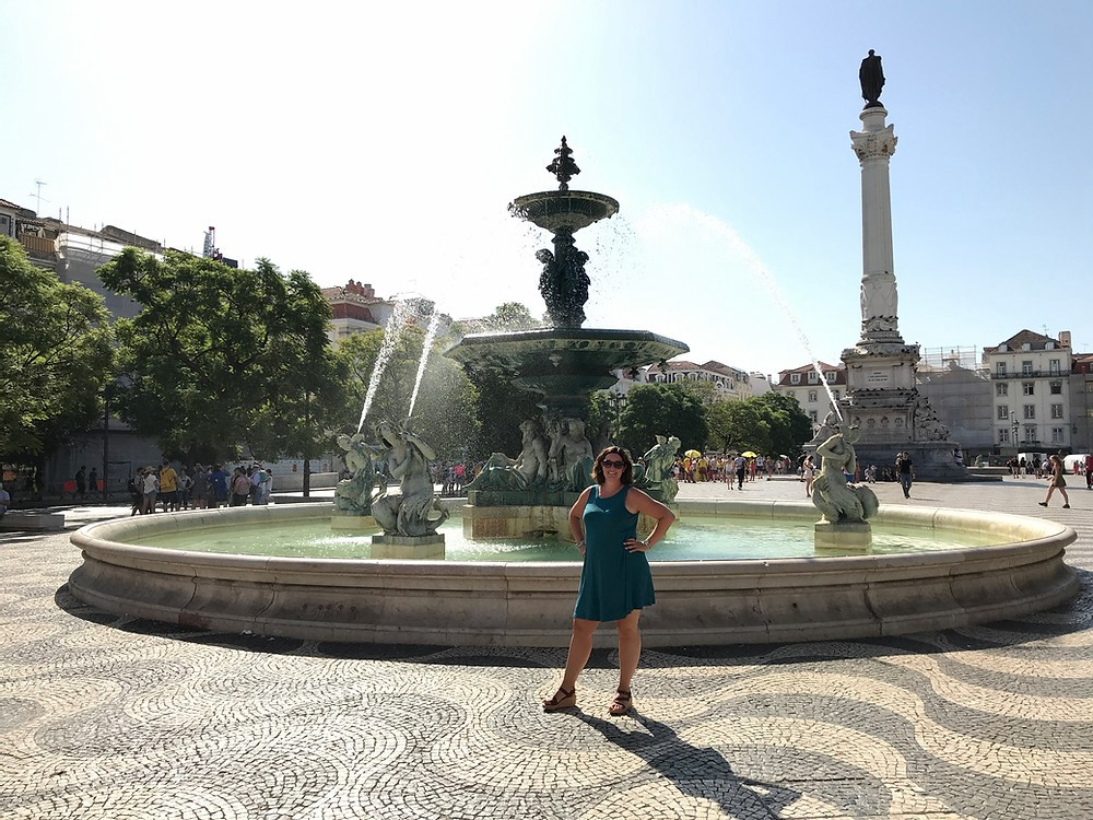 Woman in front of a fountain.
