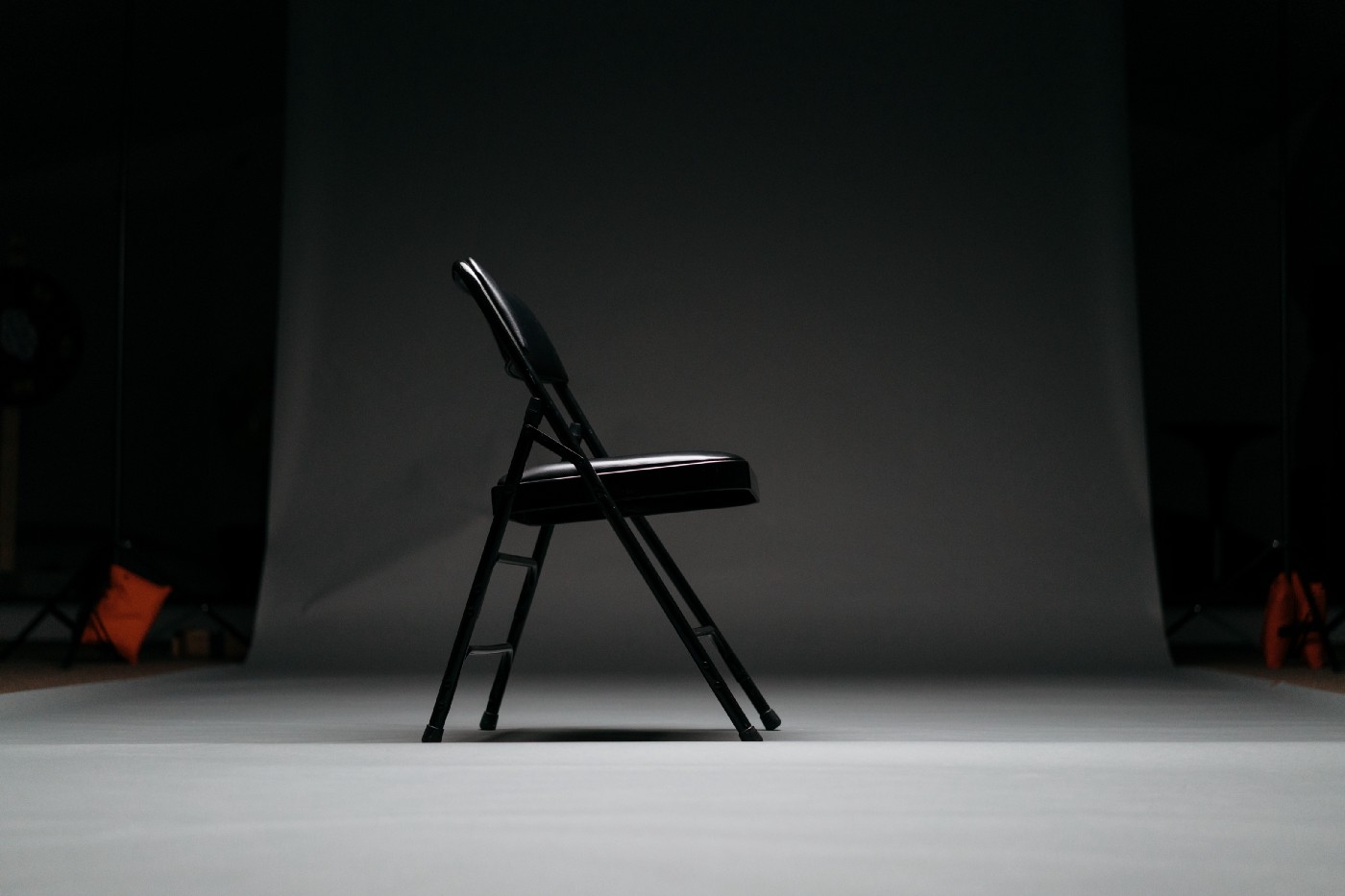 Black chair in an empty room