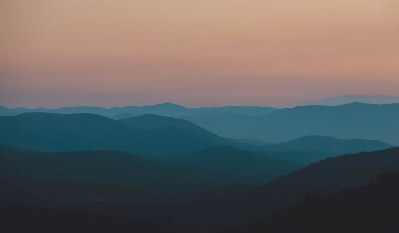 The rolling hills and mountains of Shenandoah National Park at dusk in Virginia