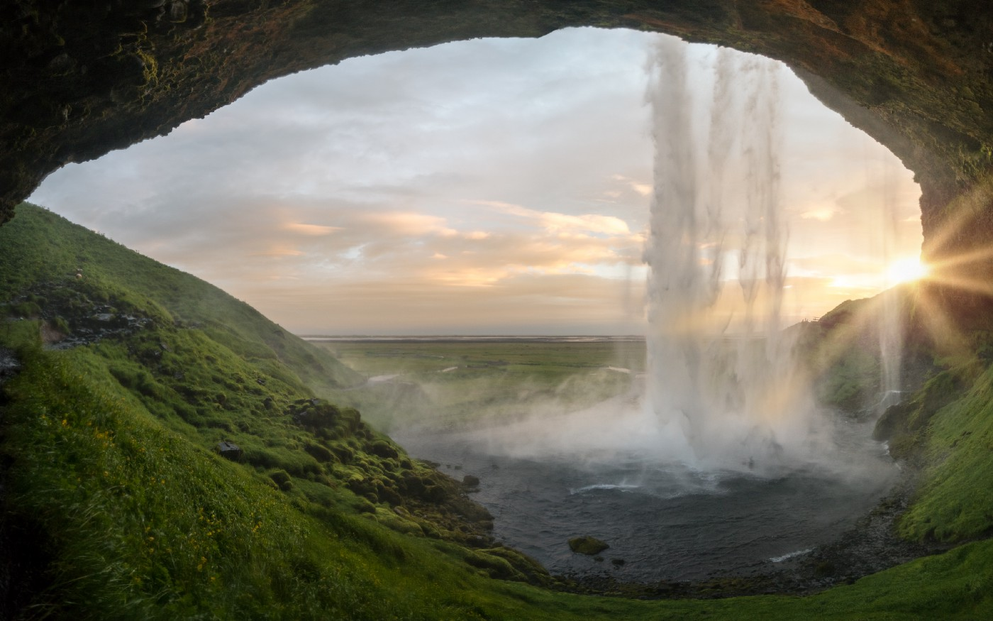 Waterfall as seen through a cave entrence