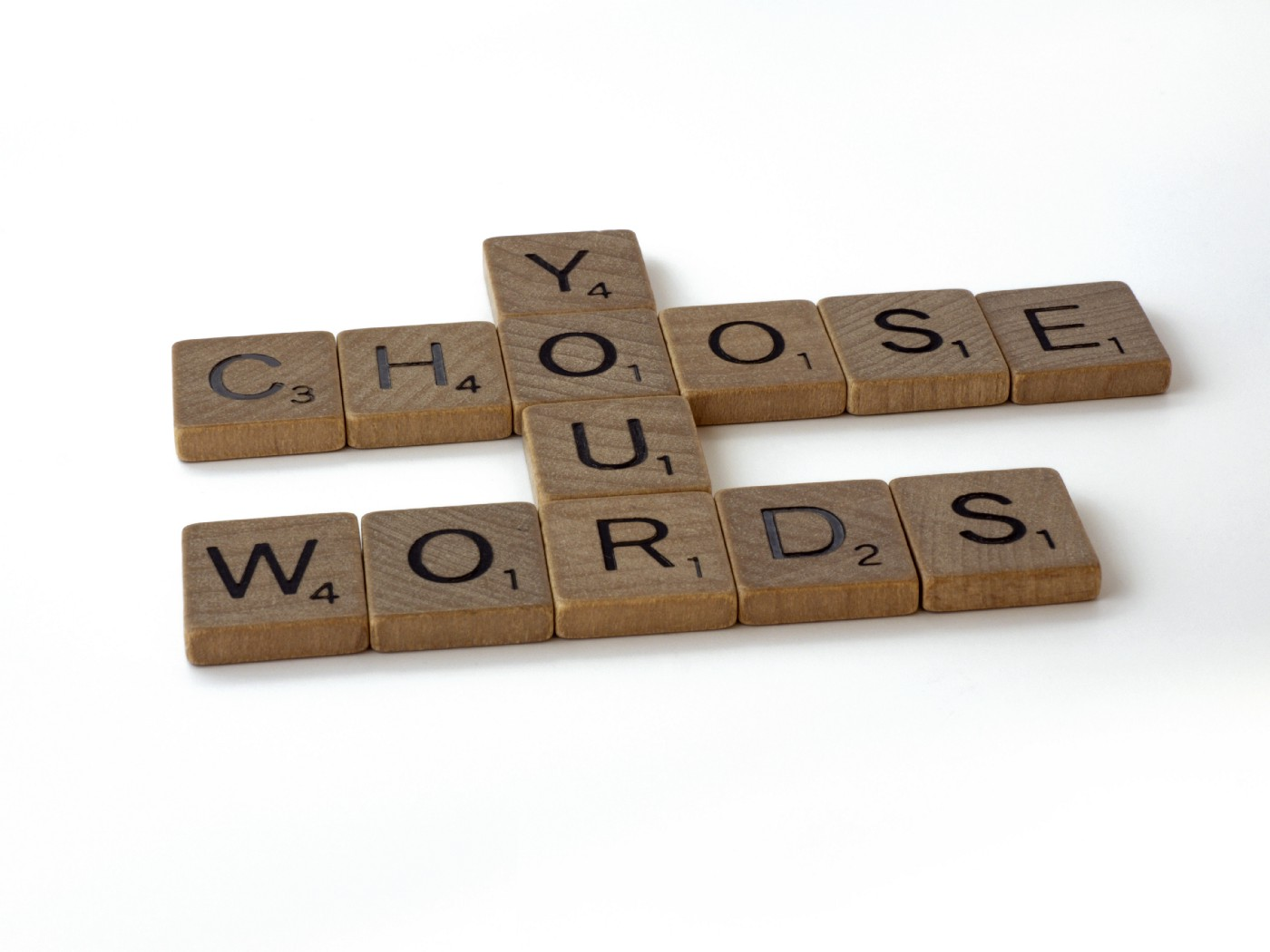 "Scrabble pieces that read ""CHOOSE YOUR WORDS."""