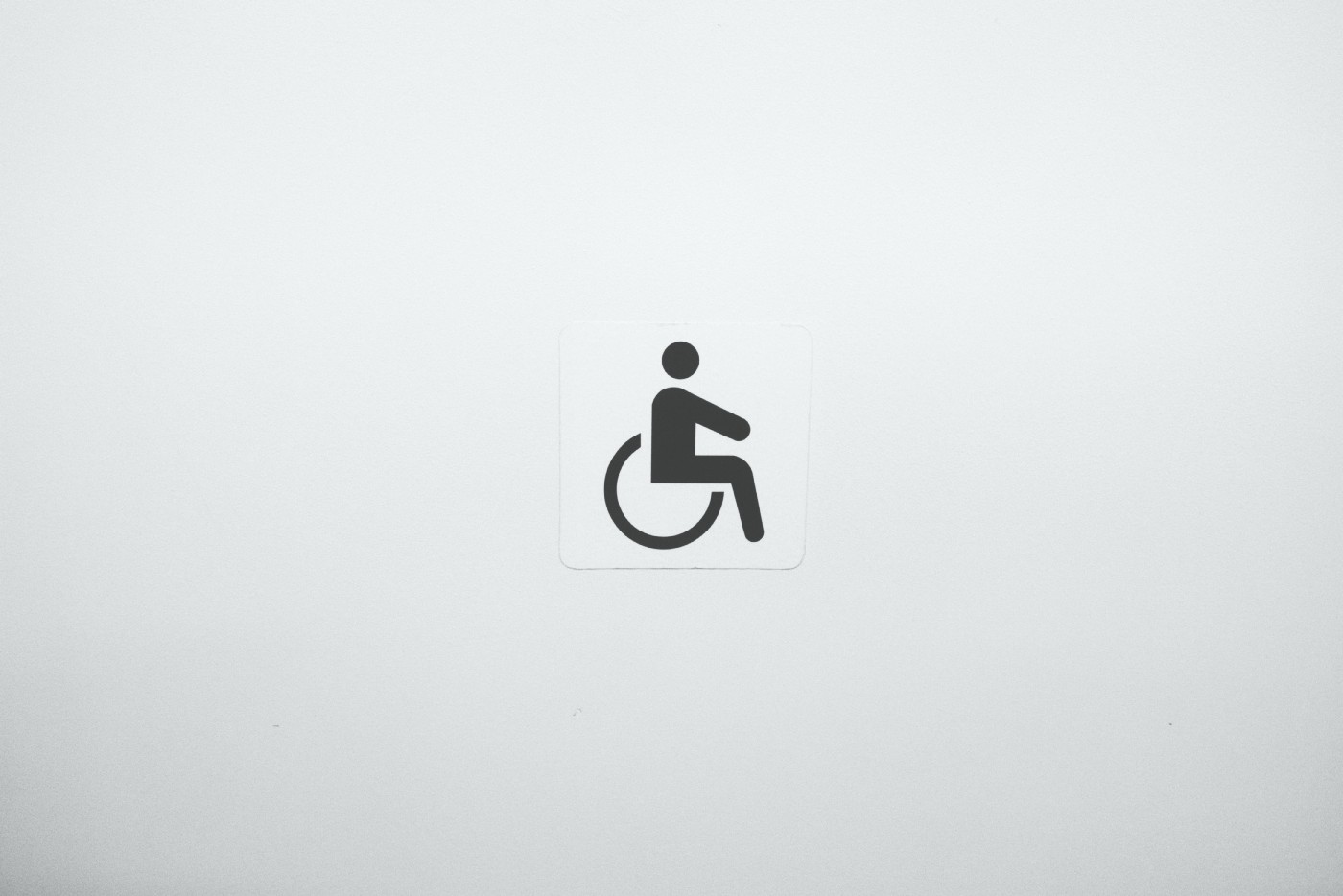 Well-known disability symbol (I.e. cartoon silhouette of human figure sitting in wheelchair)