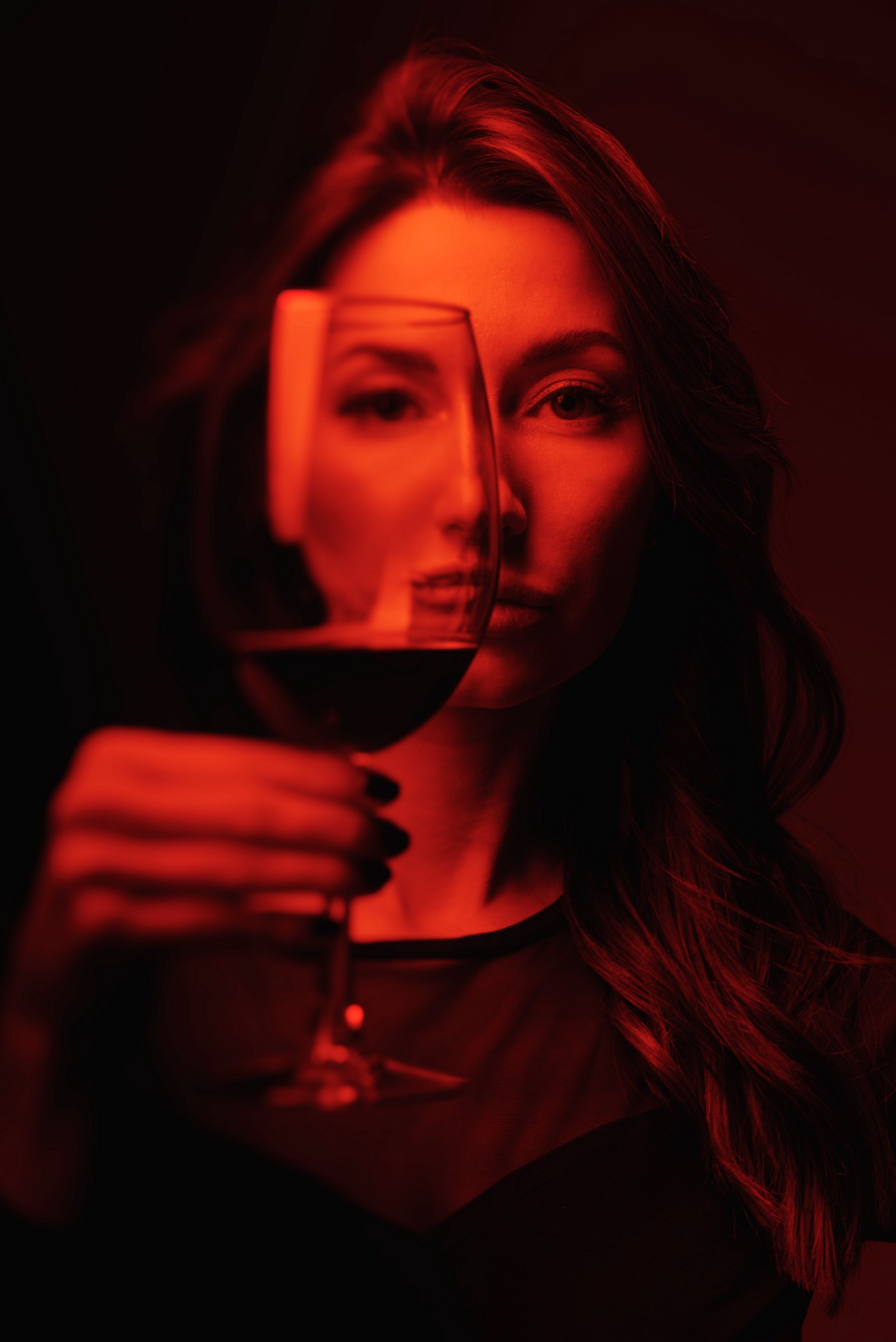 Attractive woman holding a glass of red wine