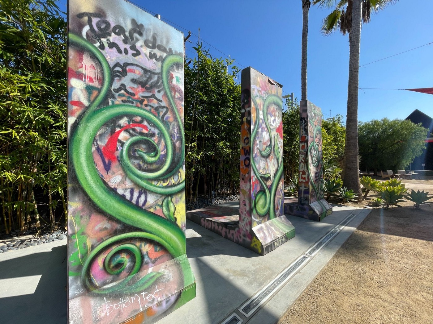 A graffiti exhibit by @muckrock at the Wende Museum.