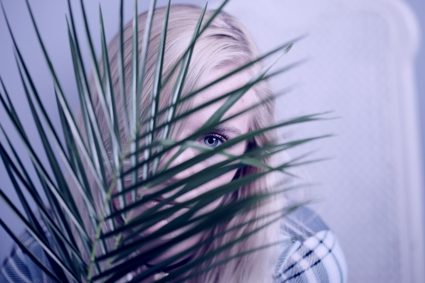 girl spying through a plant