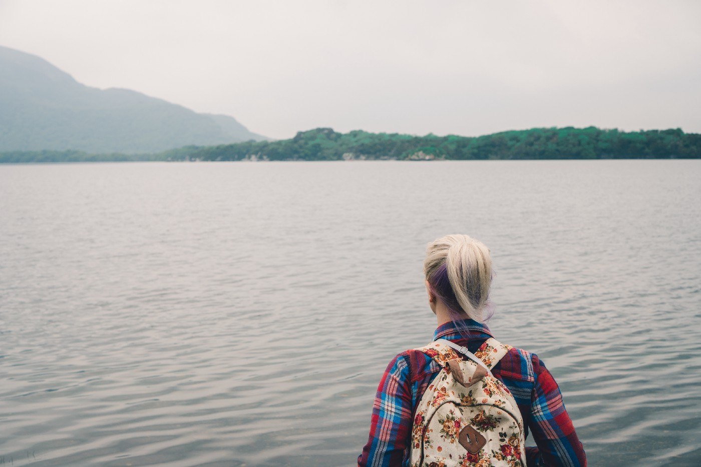 Image of female staring into a lake