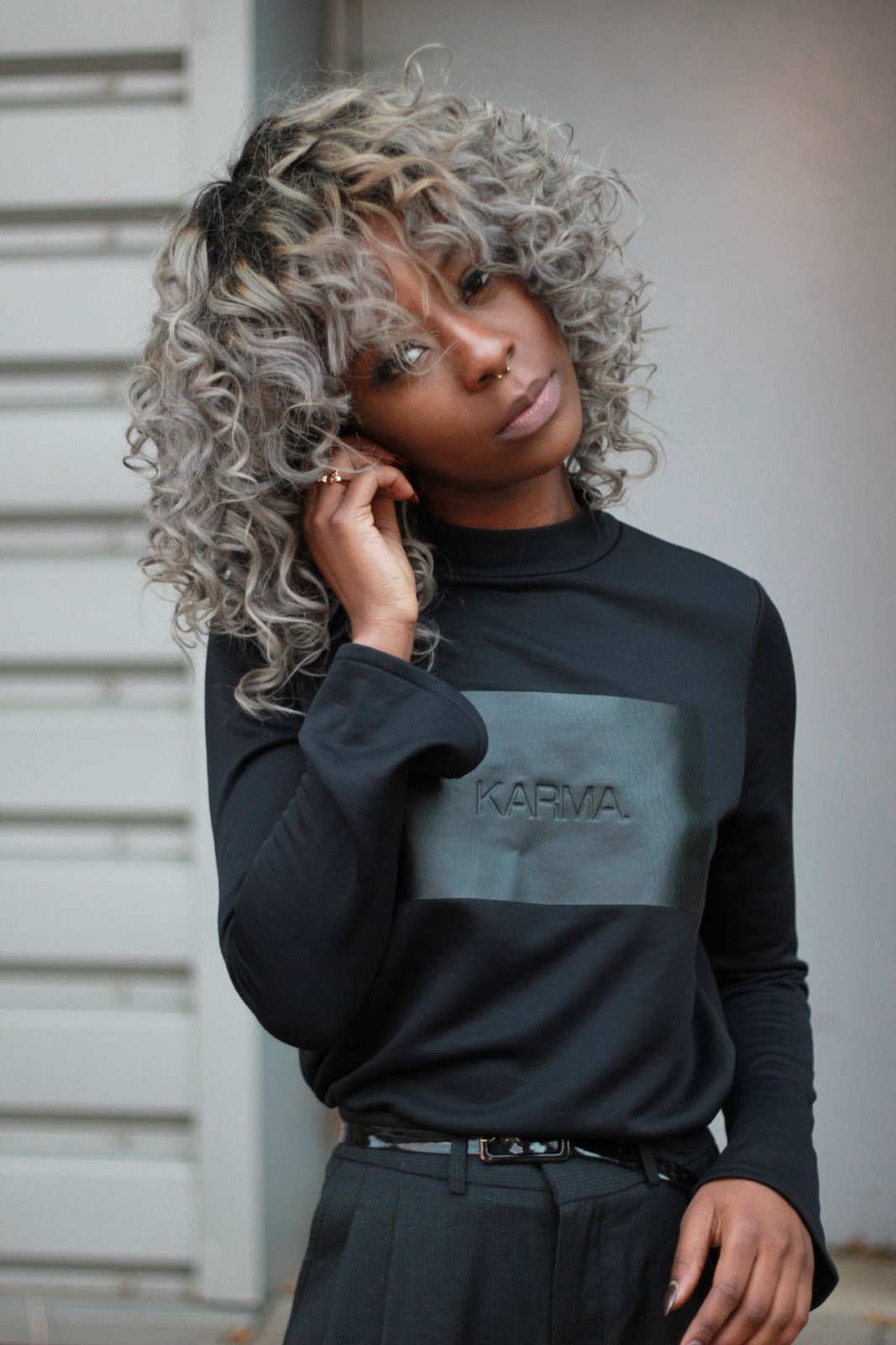 Dull grey style with curly bangs